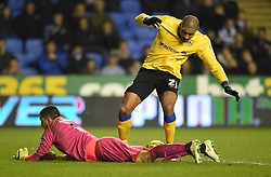 Reading's Adam Federici and Wigan Athletic's Leon Clarke - Photo mandatory by-line: Paul Knight/JMP - Mobile: 07966 386802 - 17/02/2015 - SPORT - Football - Reading - Madejski Stadium - Reading v Wigan Athletic - Sky Bet Championship