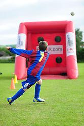 A young fan attempts to kick the ball into the Bristol City Community Park goal - Photo mandatory by-line: Dougie Allward/JMP - Tel: Mobile: 07966 386802 03/07/2013 - SPORT - FOOTBALL - Bristol -  Ashton and Backwell United V Bristol City - Pre Season Friendly