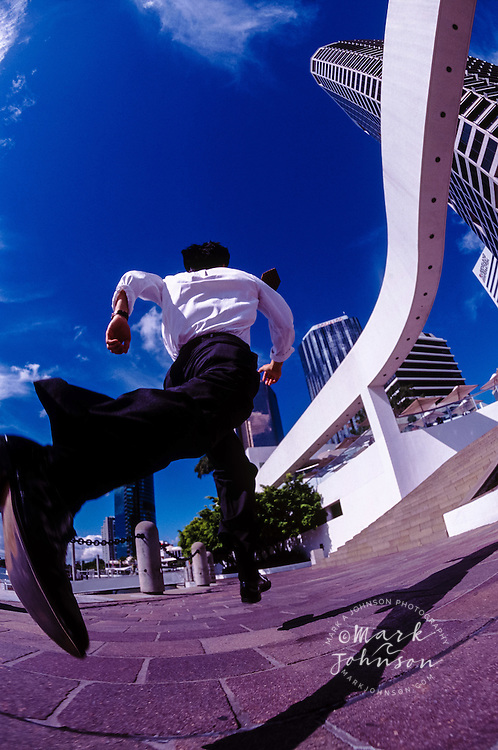 Running to work --- Image by © Mark A. Johnson/CORBIS