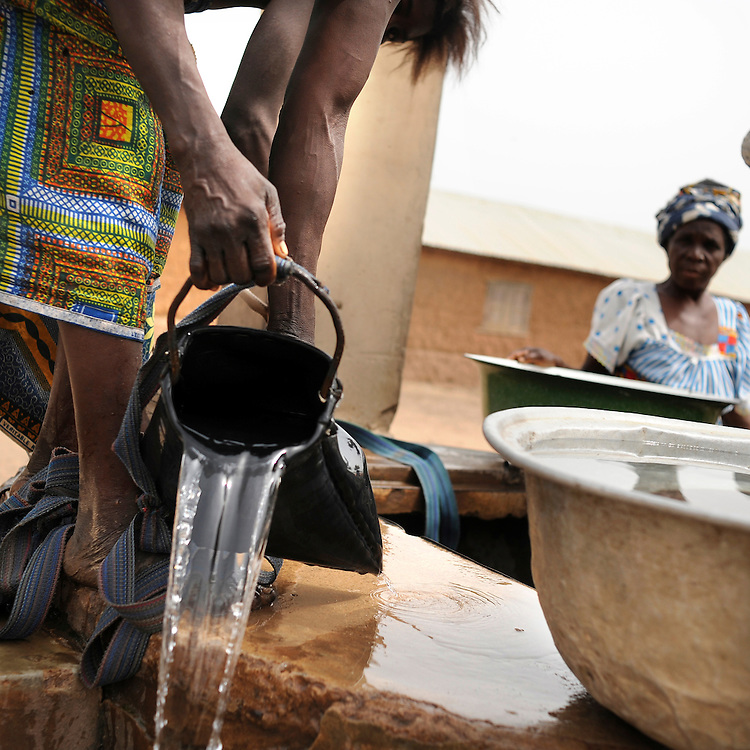 Benin February 24, 2008 Beninese woman collect water from the well at the village of Kpataba