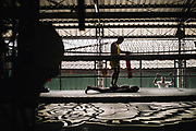 Bangkok  March 2014, Inmates during a Muay Thai (kickboxing) training session at the Klong Prem high-security prison.  Klong-prem Central Prison, or generally called Lad-yao prison, is a high-security prison in Bangkok, taking in custody of male offenders whose sentence term is not over 25 years. With its general capacity to incarcerate offenders (5000+), the prison currently takes in custody of both Thai and foreign nationals. <br /> The inmates is part of a program that pits prisoners against foreign Muay Thai fighters or others inmates for a chance of reduced sentencing or early release. In 2012 an Estonian entrepreneur, in conjunction with Thailand's Department of Corrections, began a series of bouts arranged between Thai prisoners and Western Muay Thai fighters under the banner 'Prison Fight'. For the prisoners a victory holds the potential of time off their sentence while the Westerners fight for a small purse and personal ambition. Since the launch of 'prison fight' a number of prisons have adopted the idea, encouraging prisoners to take up boxing to fight drug abuse and to give them a purpose while incarcerated.Bangkok  Mars 2014, <br /> Des d&eacute;tenus lors d'une s&eacute;ance de formation au Muay Thai (kickboxing) &agrave; la prison de haute s&eacute;curit&eacute; de Klong Prem. La prison centrale de Klong-prem, ou prison de Lad-yao, est une prison de haute s&eacute;curit&eacute; de Bangkok qui accueille en d&eacute;tention des d&eacute;linquants de sexe masculin dont la peine ne d&eacute;passe pas 25 ans. Avec sa capacit&eacute; g&eacute;n&eacute;rale d'incarc&eacute;ration des d&eacute;linquants (plus de 5 000), la prison accueille actuellement des ressortissants tha&iuml;landais et &eacute;trangers en d&eacute;tention. <br /> Les d&eacute;tenus font parties d'un programme qui oppose les d&eacute;tenus &agrave; des combattants &eacute;trangers du Muay Thai ou &agrave; d'autres d&eacute;tenus pour obtenir une r&eacute;duction de peine ou une lib&eacute