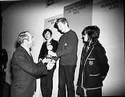 1972.07/01/1972.01/07/1972.7th January 1972.The Aer lingus Young Scientist Exhibition at the RDS, Dublin..George Colley T.D Minister for Finance presenting the trophy to the Young Scientist of the Year Sean Mac Fheorais from Colaiste Mhuire, Cearnog Pharnell, Dublin. Also pictured Geraldine O'Hagan (right) from Mt Lourdes Grammar School, Enniskillen, Co. Fermanagh and Patrick Owen Mullins(left) from St Peters College, Wexford, both runners up.