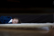 (10/9/2913 Syracuse N.Y. Samuel Koh Backer, 17 months, takes a long mid day nap.  He refuses to sleep in his crib and chooses the rug in the livingroom, instead.