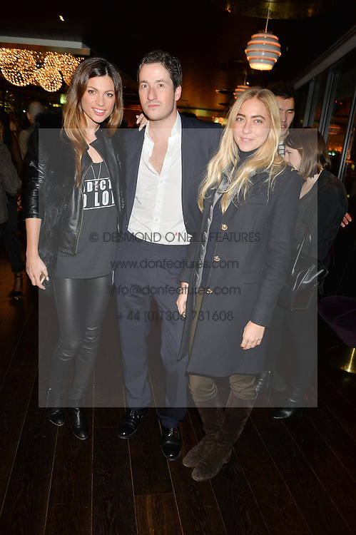 Left to right, MARTINA SPUZEVIC, BLAISE PATRICK and ALINA KOHLEM at the Launch Of Osman Yousefzada's 'The Collective' 4th edition with special guest collaborator Poppy Delevingne held in the Rumpus Room at The Mondrian Hotel, 19 Upper Ground, London SE1 on 24th November 2014, sponsored by Storm models and Beluga vodka.