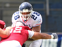 11.07.2011, UPC Arena, Graz, AUT, American Football WM 2011, Group B, Japan (JAP) vs France (FRA), im Bild Laurent Marceline   (France, #28, RB ) gets a hard tackle from Takeshi Nishikawa  (Japan, #92, DL)  // during the American Football World Championship 2011 Group B game, Japan vs France, at UPC Arena, Graz, 2011-07-11, EXPA Pictures © 2011, PhotoCredit: EXPA/ T. Haumer