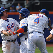 Juan Uribe, (center), New York Mets, celebrates with team mates after driving in the winning run in the tenth inning of the Mets 3-2 win during the New York Mets Vs Los Angeles Dodgers MLB regular season baseball game at Citi Field, Queens, New York. USA. 26th July 2015. Photo Tim Clayton