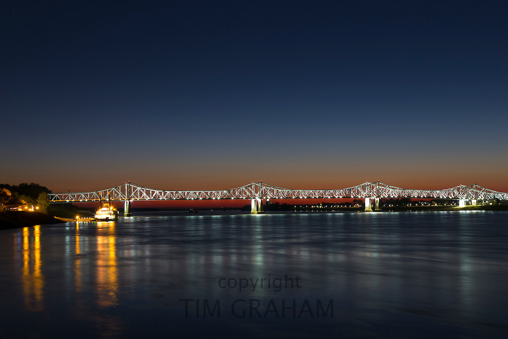 Nighttime scene of illuminated iron cantilever Natchez - Vidalia Bridge road bridge across the Mississippi River in Louisiana, USA