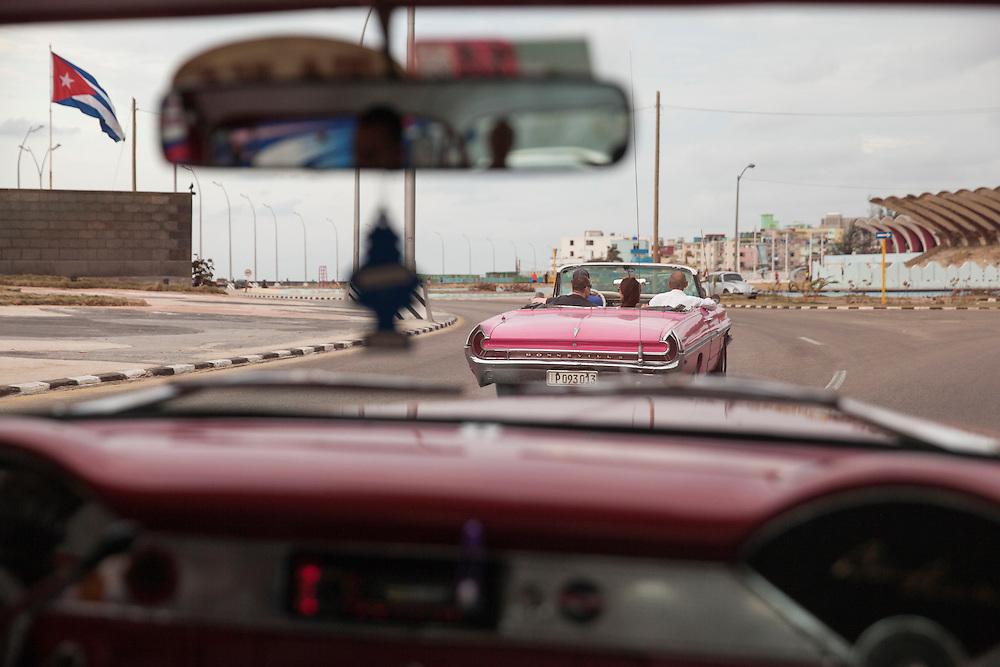 Traffic on Malecon avenue in Havana, Cuba.