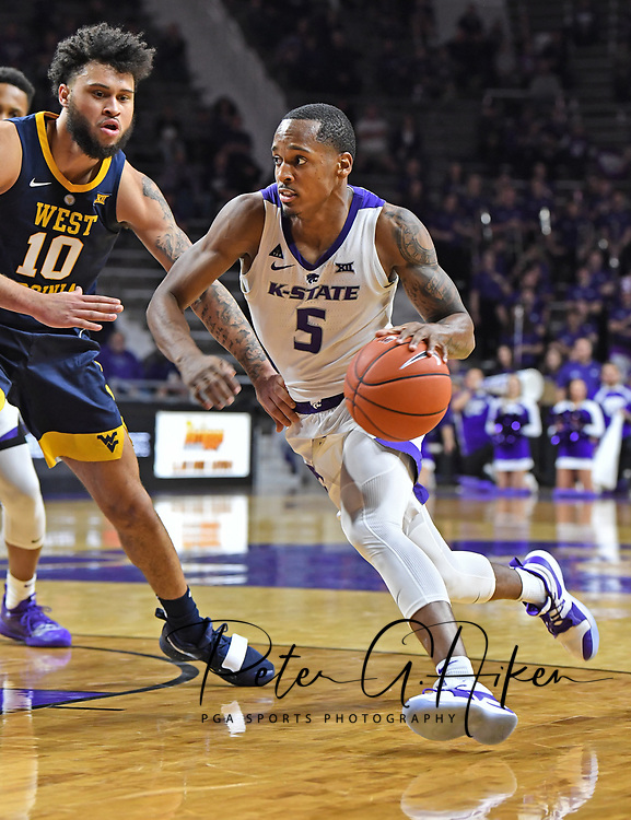 MANHATTAN, KS - JANUARY 09:  Barry Brown Jr. #5 of the Kansas State Wildcats drives in to the basket against Jermaine Haley #10 of the West Virginia Mountaineers during the second half on January 9, 2019 at Bramlage Coliseum in Manhattan, Kansas.  (Photo by Peter G. Aiken/Getty Images) *** Local Caption *** Barry Brown Jr.;Jermaine Haley