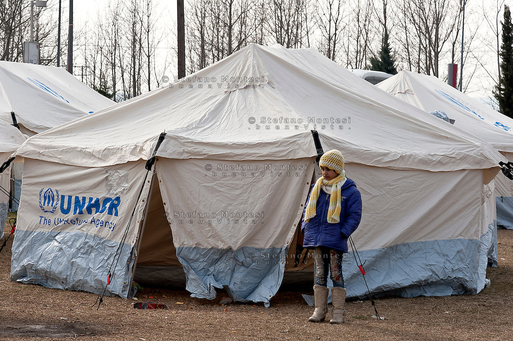 A tent city was set up by the United Nations High Commissioner for Refugees in gas station, that arriving by bus from Athens near Greece - Macedonian border, 9 Febraury 2016. Hundreds of refugees wait every day at a gas station used as a temporary camp outside of Polykastro city at the north part of Greece until they receive the order from the police to move to the Greece- Macedonian border and continue their trip to North Europe.