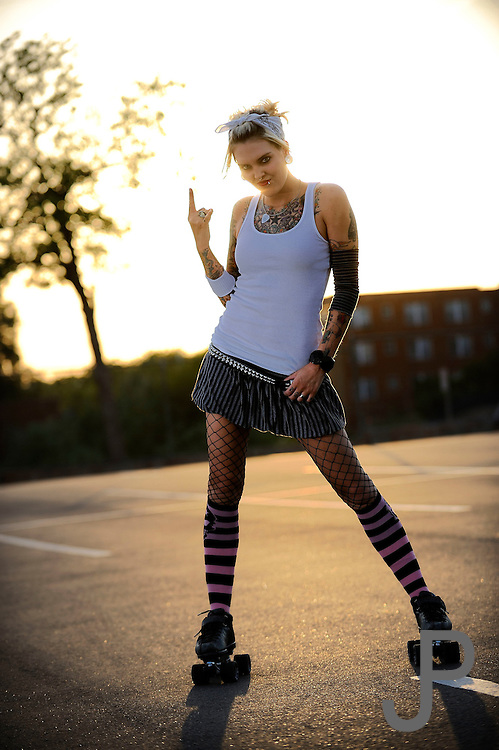 Emily Murry, aka Suzi Uzi of the Oklahoma City Red Dirt Rebellion Roller Girls banked track roller derby team