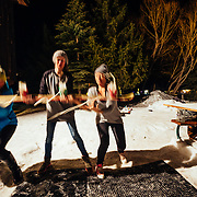 Spectators and Hostel X team members practice grabbing the beer ski during evening practice.