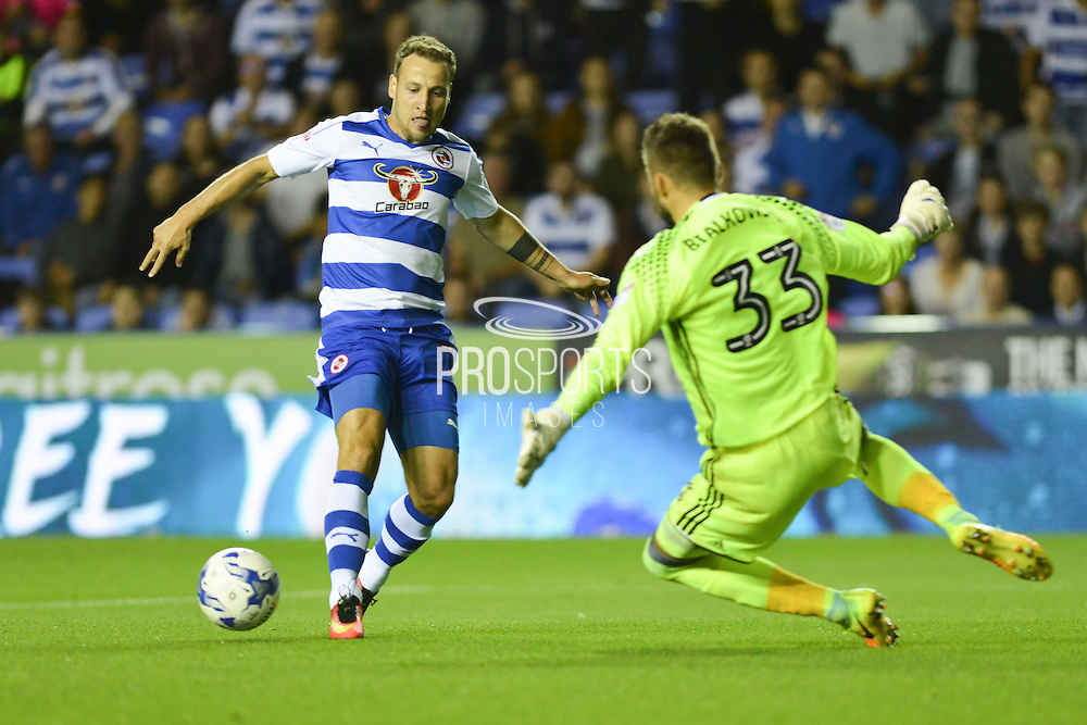 Reading FC striker (7) Roy Beerens takes on Ipswich Town goalkeeper Bartosz Bialkowski (33) during the EFL Sky Bet Championship match between Reading and Ipswich Town at the Madejski Stadium, Reading, England on 9 September 2016. Photo by Mark Davies.