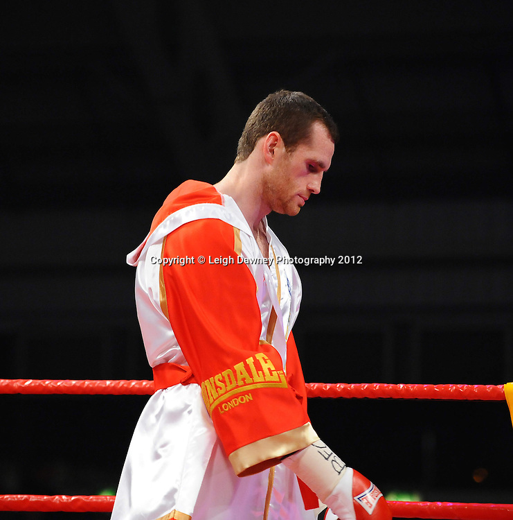 David Price defeats Matt Skelton in round two of a 12x3 contest for the British & Commonwealth Heavyweight Title on the 30th November 2012 at Aintree Equestrian Centre, Aintree, Liverpool. Frank Maloney Promotions. Pictures by Leigh Dawney. ©leighdawneyphotography 2012.