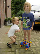 two kids having fun while posing for photo