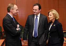 Luc Frieden, Luxembourg's finance minister, left, speaks with George Papaconstantinou, Greece's finance minister, center, and Elena Salgado, Spain's finance minister, right, during the Eurogroup meeting in Brussels, Monday Dec. 6, 2010. (Photo © Jock Fistick)