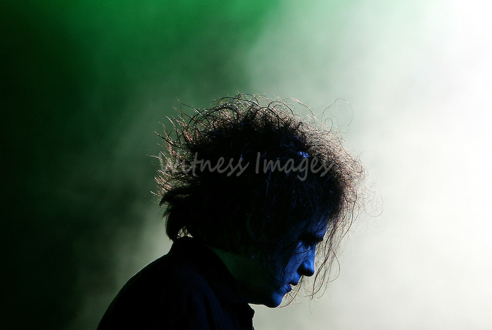 Robert Smith, singer of British band The Cure, performs during the Live 8 France concert at the Chateau de Versailles near Paris.  Robert Smith, singer of British band The Cure, performs during the Live 8 France concert at the Chateau de Versailles near Paris July 2, 2005. A galaxy of rock and roll stars grace stages across the globe on Saturday for what is being billed as the greatest music show ever, in a bid to put pressure on leaders of the Group of Eight major industrialised nations meeting in Scotland next week to do more to alleviate poverty, particularly in Africa. Live 8, an expanded version of the Live Aid sensation 20 years ago, takes in 10 cities and four continents, kicking off in Tokyo in the east and ending in North America in the west. REUTERS/Thierry Roge