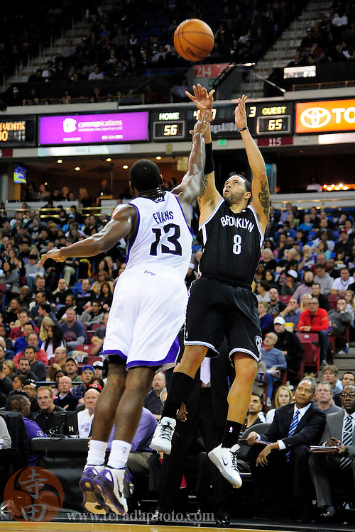 November 18, 2012; Sacramento, CA, USA; Brooklyn Nets point guard Deron Williams (8) shoots the ball over Sacramento Kings point guard Tyreke Evans (13) during the third quarter at Sleep Train Arena. The Nets defeated the Kings 99-90.