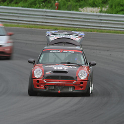 May 23, 2009; Lakeville, CT, USA; The RSR Motorsport Mini Cooper S driven by Jade Buford and Owen Trinkler has it's trunk latch fail late during the Grand-Am Koni Sports Car Challenge series competition during the Memorial Day Road Racing Classic weekend at Lime Rock Park.