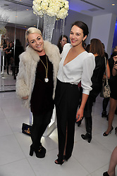 Left to right, JAIME WINSTONE and JESSICA BROWN FINDLAY at the pre party for the English National Ballet's Christmas performance of The Nutcracker held at the St.Martin's Lane Hotel, St.Martin's Lane, London on 14th December 2011.