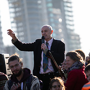Thousands of Extinction Rebellion activists took over 5 bridges in Central London and blocked them for the day, November 17 2018, Central London, United Kingdom. Lambeth Bridge; a speaker adresses the crowd sitting in the road.  Around 11am people on all bridges sat down in the road and blocked traffic from coming through and stayed till late afternoon. The actvists believe that the government is not doing enough to avoid catastrophic climate change and they demand the government take radical action to save future generations and the planet. Many are willing to be arrested peacefully protesting and up to 80 were arrested on the day.Extinction Rebellion is a grass root climate change group started in 2018 and has gained a huge following of people commited to peaceful protests and who ready to be arrested. Their major concern is that the world is facing catastropohic climate change and they want the British government to act now to save future generations.