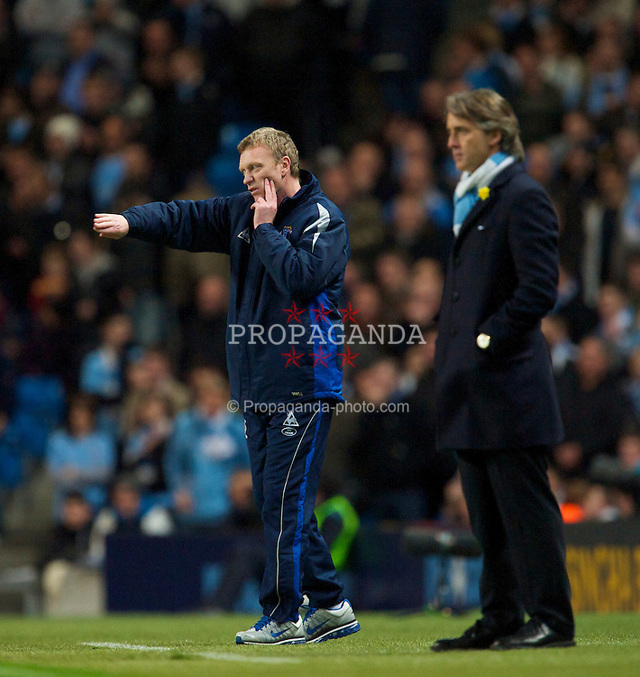 MANCHESTER, ENGLAND - Wednesday, March 24, 2010: Everton's manager David Moyes and Manchester City's manager Roberto Mancini during the Premiership match at the City of Manchester Stadium. (Photo by David Rawcliffe/Propaganda)