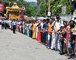 July 3, 2017 - Guwahati, India - Devotees pulling the Chariot during the Jagannath Rath Yatra 2017, organized by Harekrishna Movement Guwahati, at Panbazar in Guwahati on Monday, July 03, 2017. .Devotees pulling the Chariot during the Jagannath Rath Yatra 2017, organized by Harekrishna Movement Guwahati, at Panbazar in Guwahati on Monday, July 03, 2017. (Credit Image: © Rajib Jyoti Sarma/Pacific Press via ZUMA Wire)