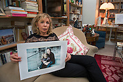 March 6, 2015, Paris, France. Maryse Wolinski  (1943, Algiers) shows a photo of her and her husband Georges Wolinski (1934 –2015) representing the couple in Venice.  Georges Wolinski and Maryse Wolinski were married and had lived for 47 years together. Two month after the death of Georges Wolinski, the apartment is full of souvenirs and notes, attesting a half-century-long love affair. Georges Wolinski was 80 years old when he was murdered by 2 French jihadists, he was one of the 12 victims of the massacre in the Charlie Hebdo offices on January 7, 2015 in Paris. Charlie Hebdo published caricatures of Mohammed, considered blasphemous by some Muslims. During his life, Georges Wolinski defended freedom, secularism and humour and was one of the major political cartoonists in France. Photo: Steven Wassenaar.