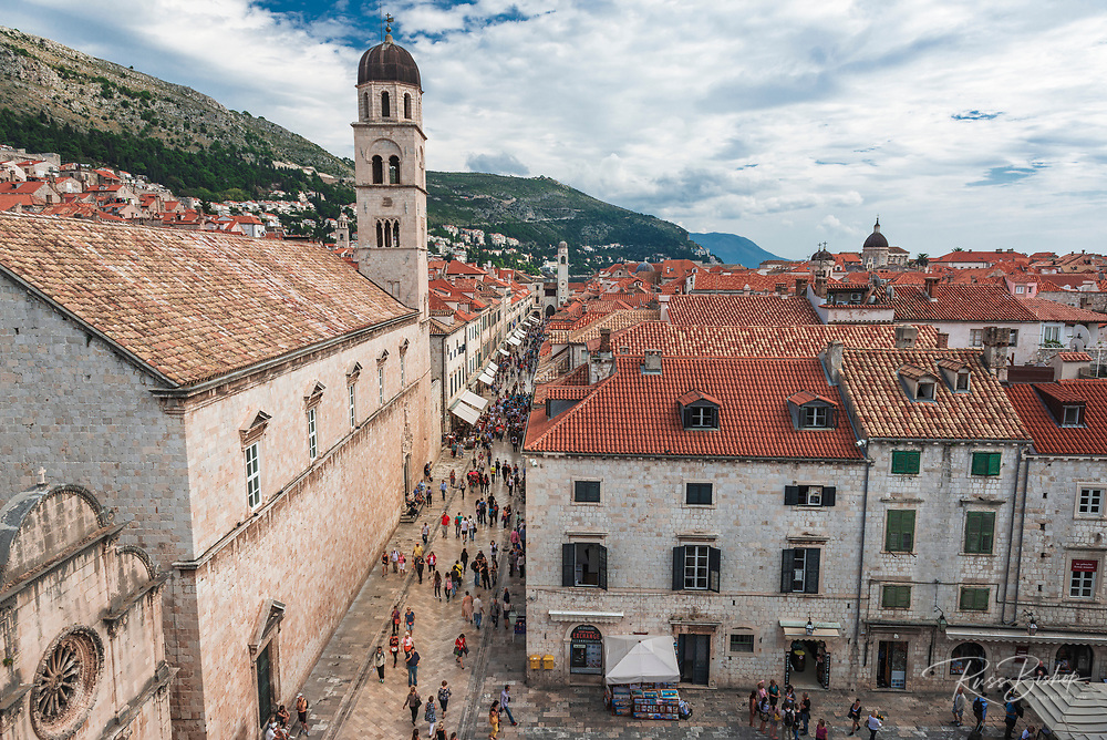 The Franciscan Monastery and tourists on the Stradun, old town Dubrovnik, Dalmatian Coast, Croatia