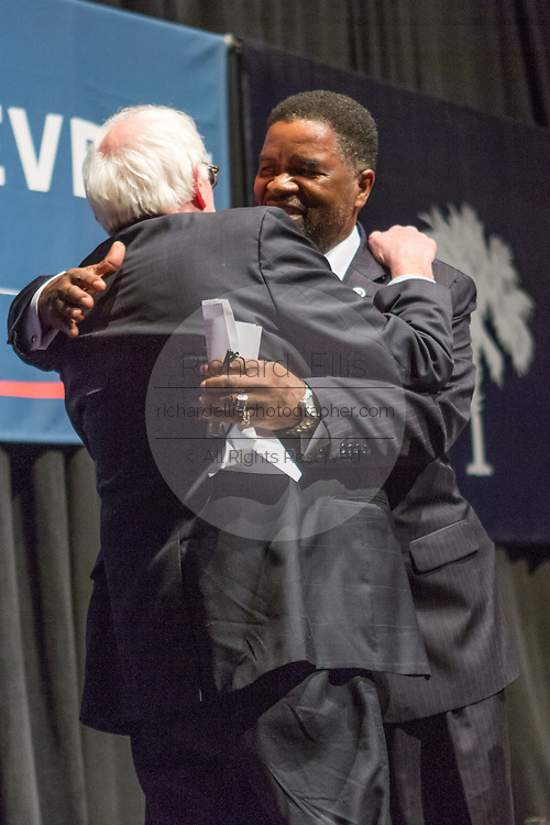 Democratic presidential candidate Senator Bernie Sanders embraces South Carolina State Rep. Wendell Gilliard before a campaign rally at the Memminger Theater February 16, 2016 in Charleston, South Carolina, USA.