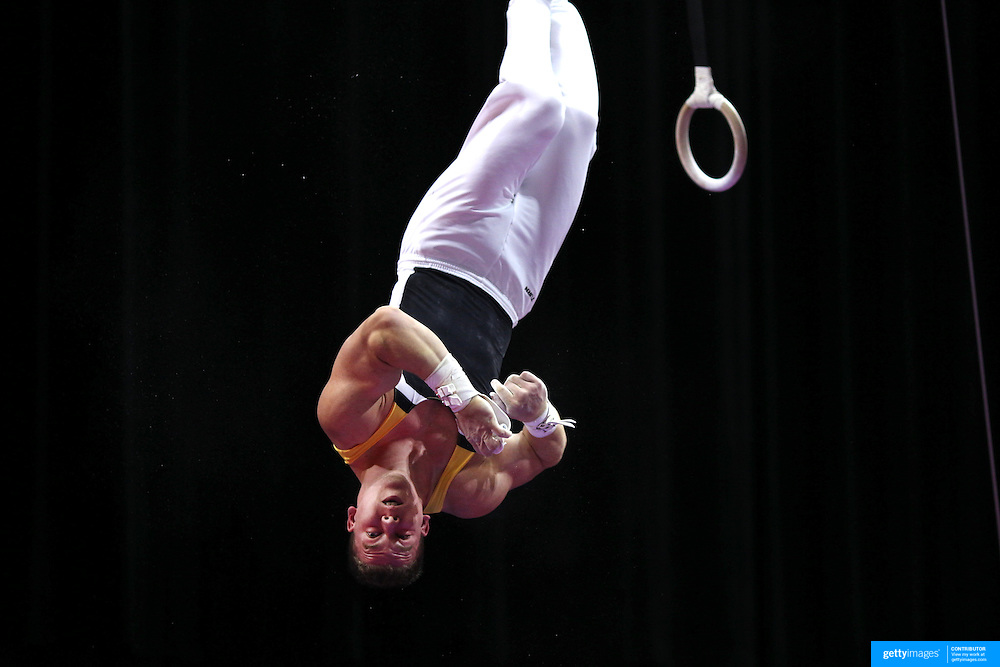 Matthew McGrath, Iowa City, Iowa, in action on the Still Rings during the Senior Men Competition at The 2013 P&G Gymnastics Championships, USA Gymnastics' National Championships at the XL, Centre, Hartford, Connecticut, USA. 16th August 2013. Photo Tim Clayton