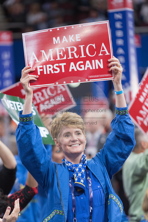 GOP delegates cheer and wave signs during the third day of the Republican National Convention July 20, 2016 in Cleveland, Ohio.