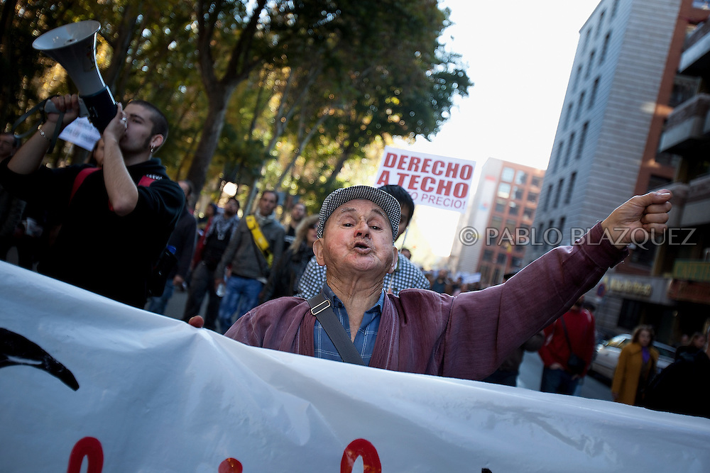 Spain's 'indignant' elder protesters march through the streets of Madrid on November 27, 2011 to protest against spending cuts, high unemployment and political corruption. A placard says 'A right to home'. Spain.(PABLO BLAZQUEZ)