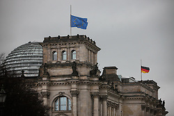 """An EU flag and a German national flag fly at half mast on the Reichstag building (the lower house of parliament) to commemorate the victims of the attack on French satirical weekly """"Charlie Hebdo"""", in Berlin, Germany, on Jan. 9, 2015. Twelve people were killed on Wednesday in a shooting at the Paris office of Charlie Hebdo weekly. EXPA Pictures © 2015, PhotoCredit: EXPA/ Photoshot/ Zhang Fan<br /> <br /> *****ATTENTION - for AUT, SLO, CRO, SRB, BIH, MAZ only*****"""