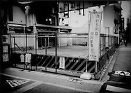 This central Tokyo petrol station, which occupied this lot beside busy Koshu Kaido for over a decade remains vacant after the station went out of business, Hatagaya, .Shibuya-Ku, Tokyo, Japan.