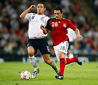 Photo: Richard Lane/Sportsbeat Images.<br />England v Germany. International Friendly. 22/08/2007. <br />England's Frank Lampard challenges Germany's Piotr Trochoski.