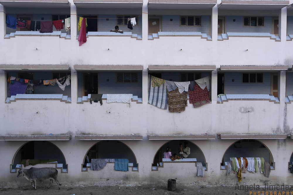 Refugees from the village of Vailankanni in Tamil Nadu, India hang their clothing from the balconies at the St. Joseph's Pilgrim's Quarters on January 28, 2005, where they are staying temporarily inland since their homes were struck by the Indian Ocean Tsunami on December 26, 2004. Generated by an earthquake on the ocean floor, the tsunami devastated the fishing industry along the southeastern coast of India.