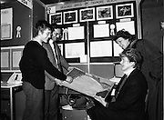 08/01/1988.01/08/1988.8th January 1988 .The Aer Lingus Young Scientist of the Year Award at the RDS, Dublin ..Colm Piercy from Tramore CBS, Co. Waterford explaining his project 'A Survey of Beached Birds on Tramore Beach' to his parents Eamonn Piercy and Rina Piercy (seated) and his aunt Alice Patton.