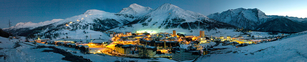 2/5/06 -- The 2006 Torino Winter Olympics -- Sestriere , Italy. An evening photograph overlooking the town of Sestrieri, Italy.  The slalom and giant slalom events will be held beginning Feb. 14 on the center mountain called Sestrier Colle.  On the left is a series of lights where the men's downhill and Super G events will be held, on the resort Sestrieri Borgata...Photo by Scott Sady, USA TODAY staff.
