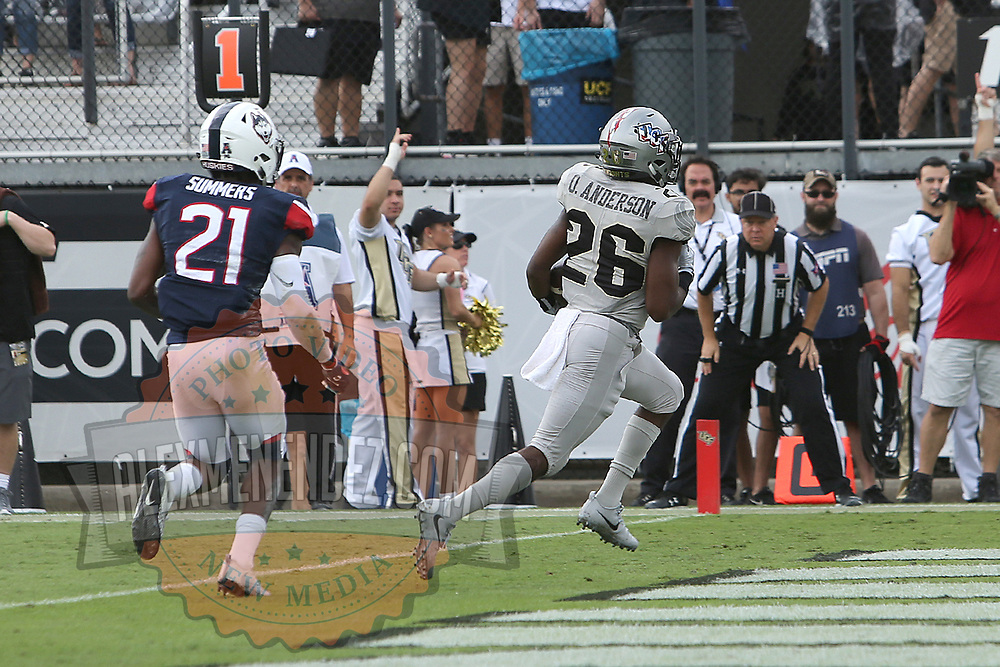 ORLANDO, FL - NOVEMBER 11: Otis Anderson #26 of the UCF Knights scores a touchdown in front of Jamar Summers #21 of the Connecticut Huskies during a NCAA football game between the University of Connecticut Huskies and the UCF Knights on November 11, 2017 in Orlando, Florida. (Photo by Alex Menendez/Getty Images) *** Local Caption *** Otis Anderson; Jamar Summers