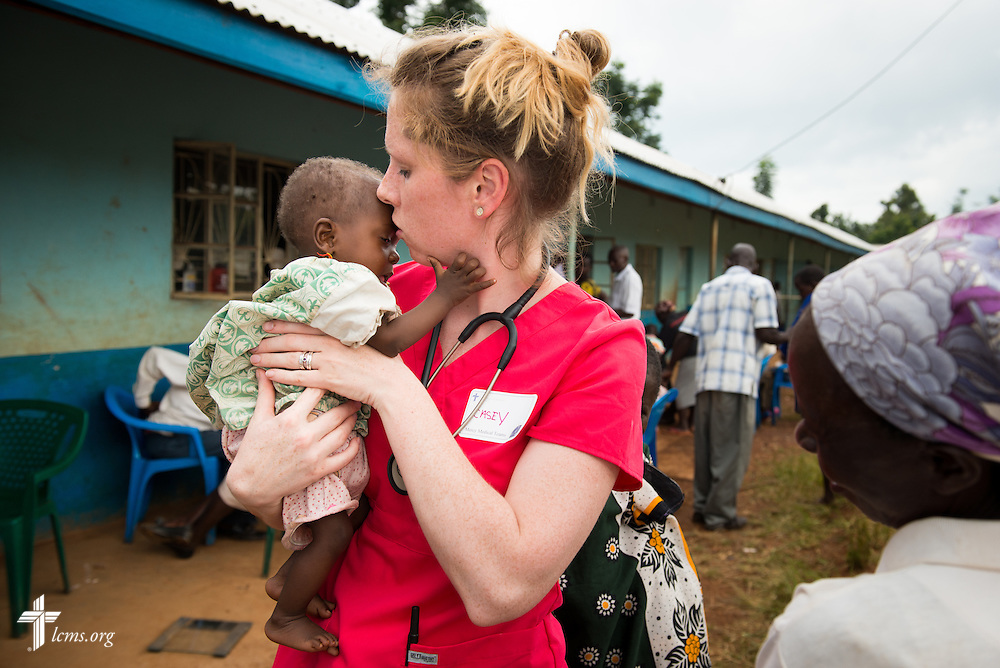 Nurse Casey Peters of Dover, N.H,  cares for an infant during the Mercy Medical Team clinic Thursday, June 12, 2014, at the Luanda Doho Primary School in Kakmega County, Kenya. LCMS Communications/Erik M. Lunsford