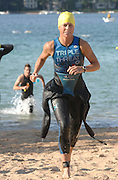 Penny Himes of Elkhart, Indiana leads the field out of Lake Michigan on her way to taking the overall female win at the inaugural Little Traverse Triathalon in Harbor Springs, Michigan.