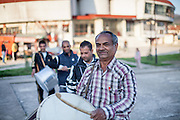 """Father Abdush (front) and his sons Mersid (last, Erdal (second) and Ergul (third) during a drum session on a stage in front of the """"House of Culture"""" in Delcevo, Macedonia. The Roma family - father and his 3 sons - are well know for their drum perfomances and also they build their drums themselves."""