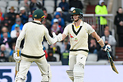 50 - Marnus Labuschagne of Australia celebrates scoring a half century and is congratulated by Steve Smith of Australia during the International Test Match 2019, fourth test, day one match between England and Australia at Old Trafford, Manchester, England on 4 September 2019.
