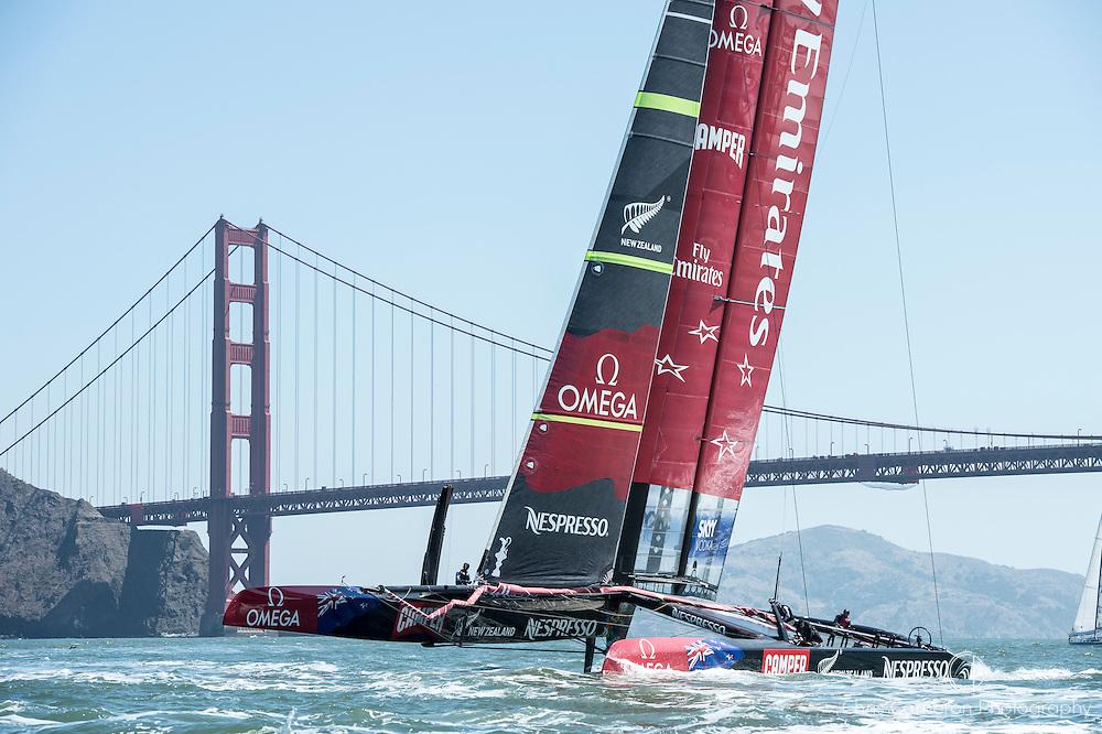 Emirates Team New Zealand AC72, NZL5 sails under the Golden Gate bridge on her first sail in San Francisco. 23/5/2013