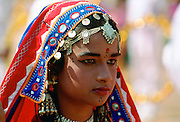 Young pretty girl in national costume and jewels at a festival in Calcutta, India