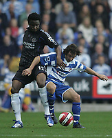 Photo: Lee Earle.<br /> Reading v Chelsea. The Barclays Premiership. 14/10/2006. Chelsea's John Obi Mikel (L) battles with Stephen Hunt.