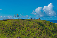 Two women talking at the top of a hill on Easter Island