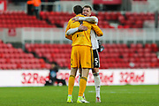 Fulham defender Alfie Mawson (5) and Fulham goalkeeper Marcus Bettinelli (1) hug following the EFL Sky Bet Championship match between Middlesbrough and Fulham at the Riverside Stadium, Middlesbrough, England on 26 October 2019.