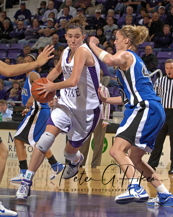 Kansas State forward Ashley Sweat (L) drives against pressure from Creighton's Sara Cain (R) in the second half at Bramlage Coliseum in Manhattan, Kansas, November 13, 2006.  K-State defeated the Bluejays 94-79.<br />